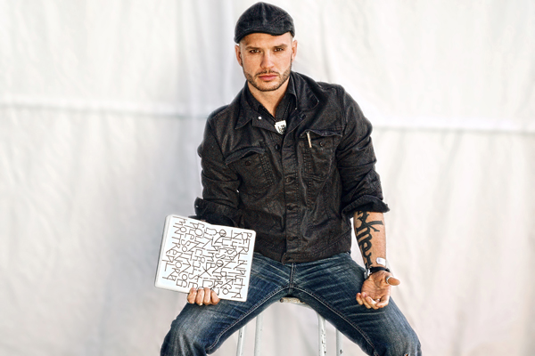 Logan Phillips: Poet, DJ, Artist, Teacher Photo: Jimi Giannatti
