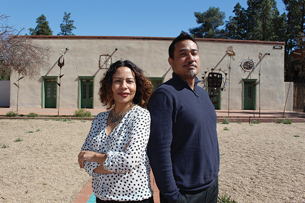 Borderlands Theater Marketing and Outreach Director Milta Ortiz (left) with Producing Director Marc Pinate (right) in front of the theater's new office/community space, the Sosa-Carrillo-Fremont House museum, at 151 S. Granada Ave. Photo by Gaby Hurtado